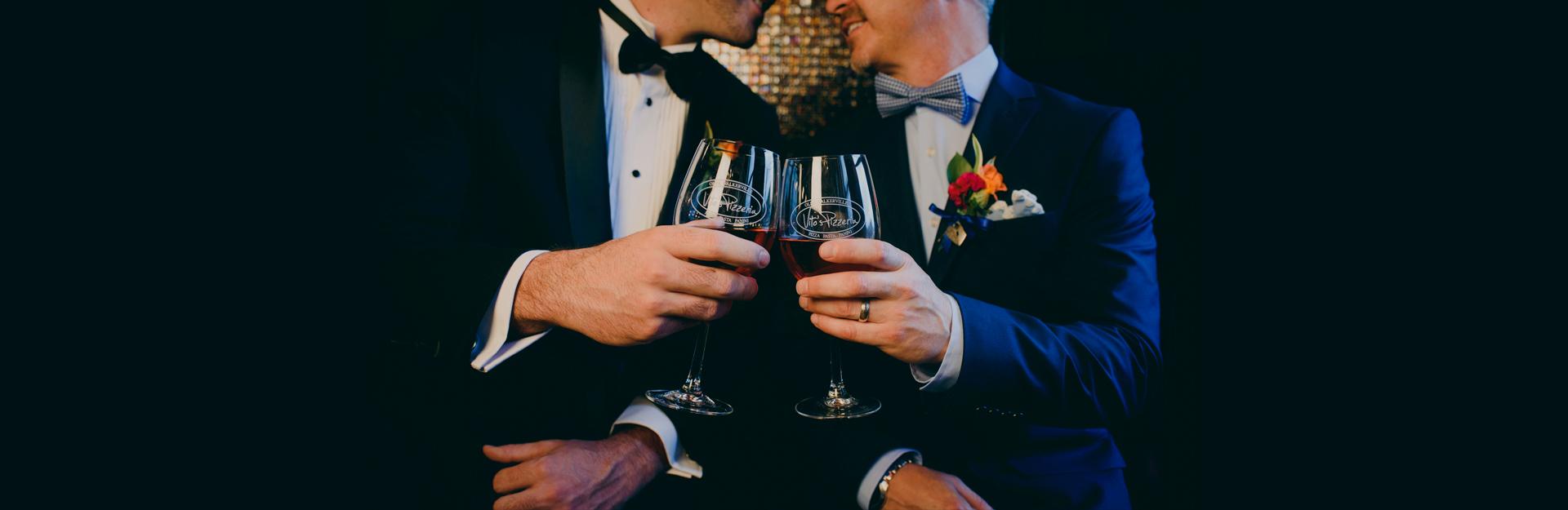two men clinking glasses